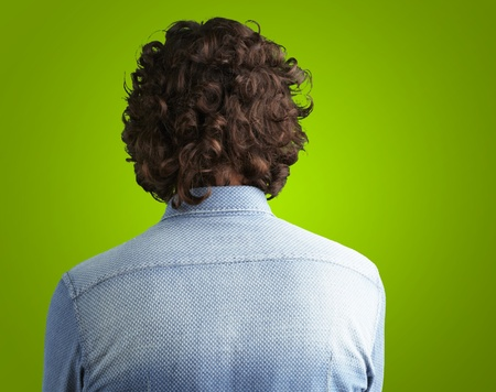 Back side view of a man against a green background photo