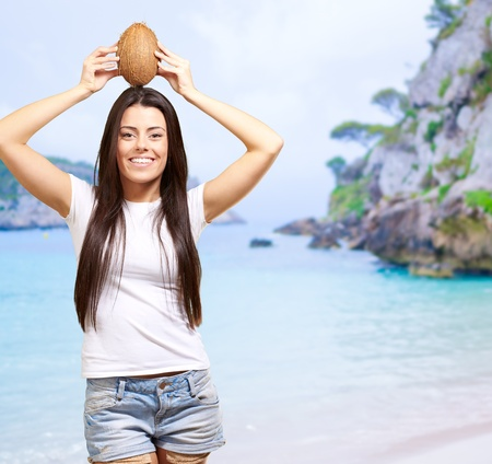 Woman On A Beach With Coconut On Head, Outdoor photo