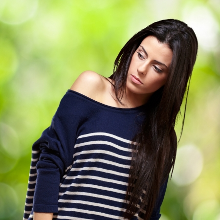 portrait of young girl standing against a nature background
