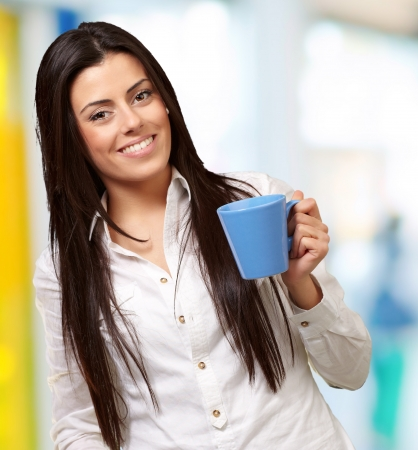 young girl holding cup indoor Stock Photo - 14703996