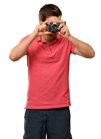 Portrait of a man taking photo on white background photo
