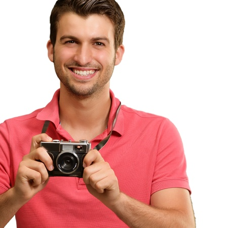 Portrait of a man holding camera on white background photo