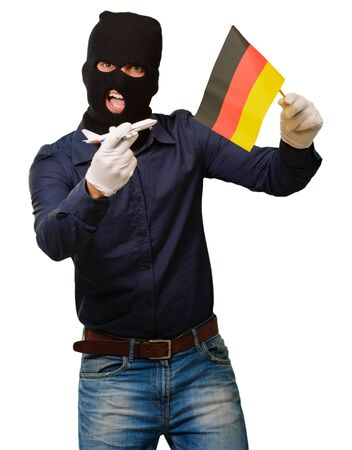 thievery: Man wearing a robber mask and holding airplane miniature and flag on white background Stock Photo