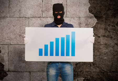 thievery: Man wearing mask holding a graph card, indoor