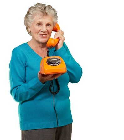 Mature Woman, Talking On Telephone On White Background photo