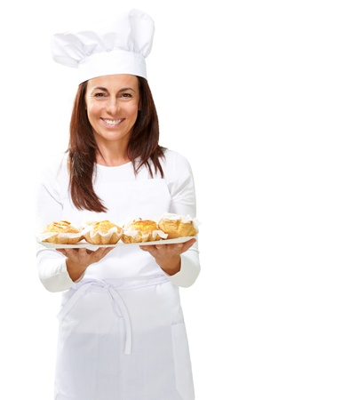 Woman chef holding baked food on white background Standard-Bild