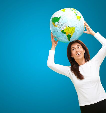 the ocean state: Women with globe on head isolated on blue background