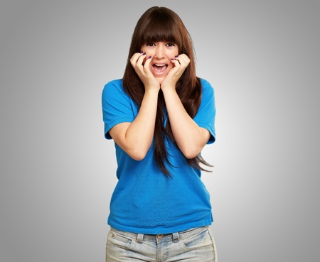young woman screaming isolated on gray background Stock Photo - 14826207