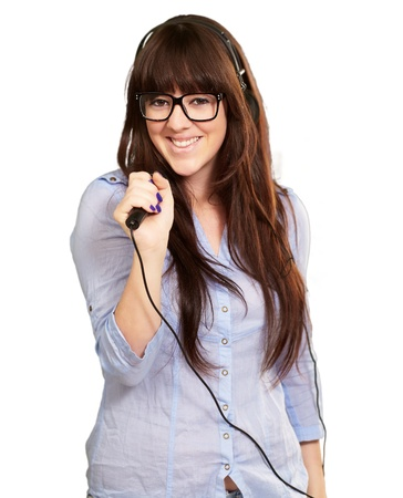 vocalist: Portrait Of A Young Female With A Mike On White Background Stock Photo