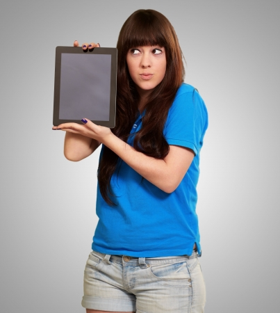 charming: Woman Holding touchpad Isolated On Gray Background Stock Photo