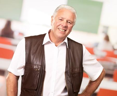 businessman standing: Senior Man Standing With Hand On Hips, Indoor