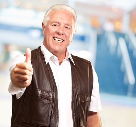 A Senior Man Showing Thumbs Up, Indoor Stock Photo - 14826094