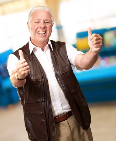 A Senior Man Showing Thumbs Up, Indoor Stock Photo - 14826180