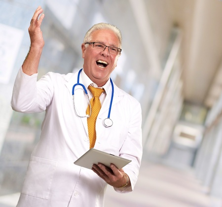 Doctor Holding A Tablet And Happy, Indoor photo