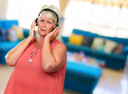 Portrait Of A Senior Woman With Headphone, Indoor photo
