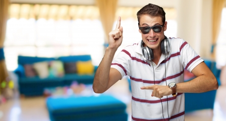Portrait Of A Man Wearing Headphone Dancing, Indoor photo