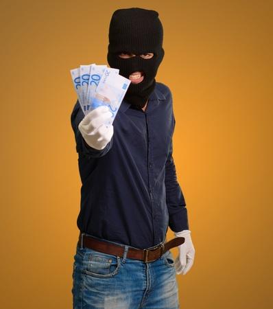 handglove: Burglar In Face Mask On Coloured Background