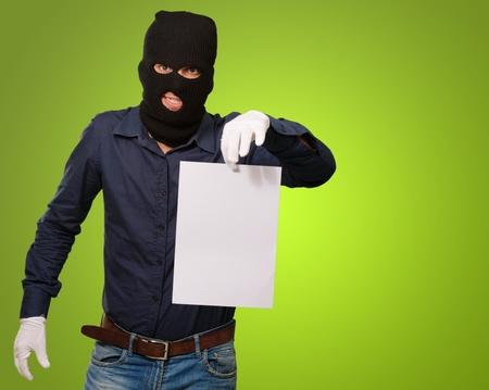 handglove: Burglar In Face Mask On Green Background