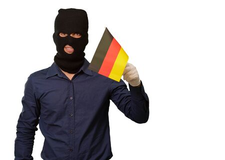 thievery: Man wearing robber mask and holding flag on white background