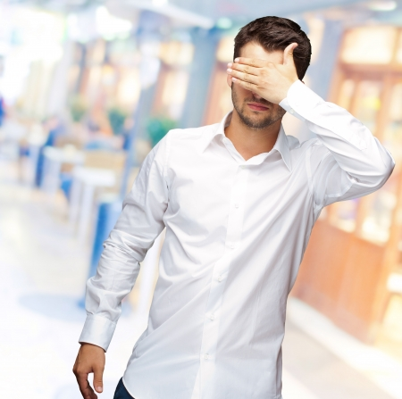 unsighted: Portrait Of An Businessman Covering Eyes, Outdoor