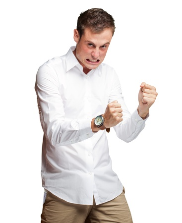 aggressive people: Portrait Of  Frustrated Young Man On White Background