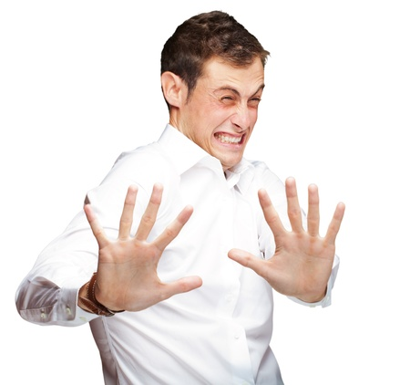 shock: A Young Man Holding His Hands Out In Fear On White Background