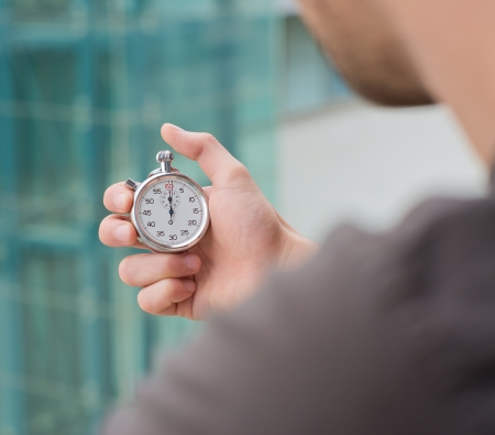 stop time: Man Holding A Stopwatch