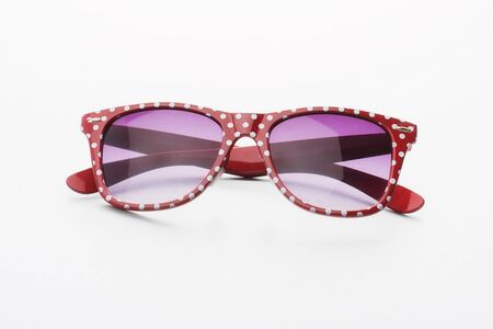 fashionable sunglasses: Funky Dotted Retro Glasses On Gray Background Stock Photo