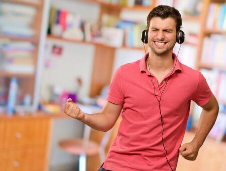 Excited Man Listening Music On Headphone Imagens
