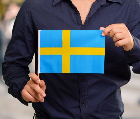 sweden flag: Man Holding Swedish Flag, Outdoor Stock Photo