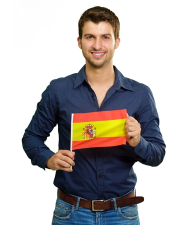 A Young Man Holding A Spain Flag On White Background Stock Photo
