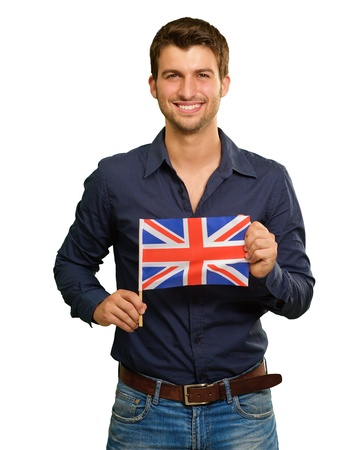 british people: A Young Man Holding A Flag Of United Kingdom On White Background Stock Photo