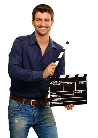 battant: Un jeune homme tenant un Clapboard Sur Fond Blanc
