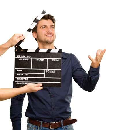 acting: A Young Man Holding A Clapboard And Acting On White Background Stock Photo