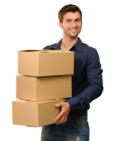 man carrying box: A Young Man Holding A Stack Of Cardboard Boxes On White Background Stock Photo