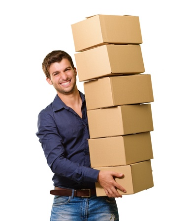A Young Man Holding A Stack Of Cardboard Boxes On White Background Imagens