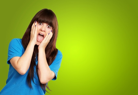 young woman screaming isolated on green background Stock Photo - 15850652