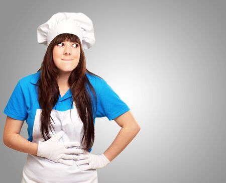 handglove: Woman Cook Paining Stomach On Gray Background Stock Photo