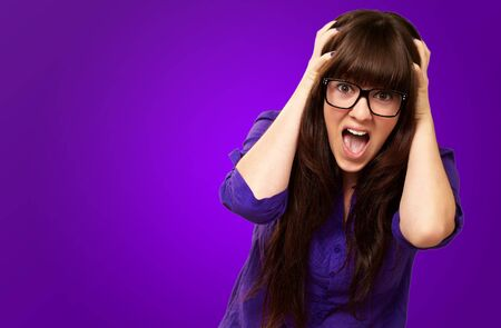 Frustrated Woman With Mouth Open Isolated On Purple Background Stock Photo - 15852312