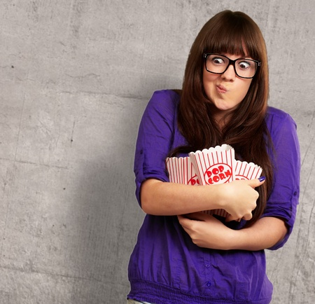 Portrait Of Young Woman Holding Popcorn Container, Background photo