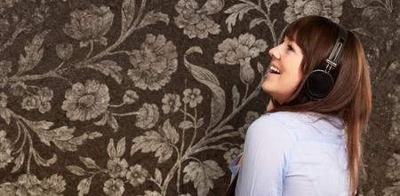 adult entertainment: Happy Woman Wearing Headphone On Wallpaper