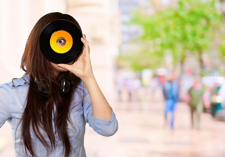 glimpse: Young Girl Looking At Vinyl, Outdoor