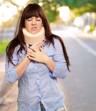 causation: Woman Wearing Neckbrace, Outdoor