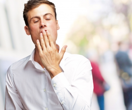 Portrait Of Young Man Yawning, Outdoor Stock Photo - 16039011