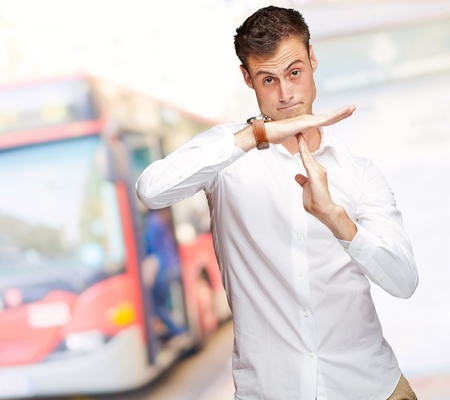 time out: Portrait Of Young Man Gesturing Time Out Sign, Outdoor Stock Photo