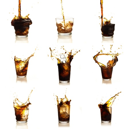 Assortment Of Cola Drinks On White Background Stock Photo