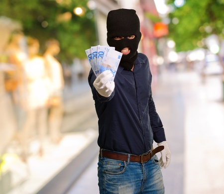 Burglar In Face Mask, Outdoor Stock Photo - 16039572