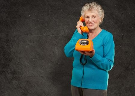 Mature Woman, Talking On Telephone, Indoor Archivio Fotografico