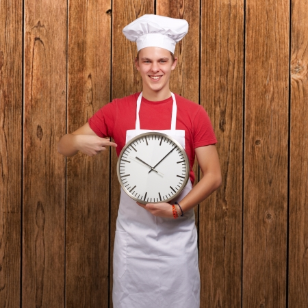 Portrait Of A Young Man Holding A Clock, Indoor photo