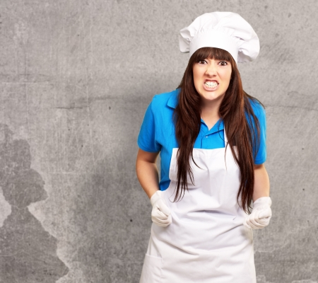 freaked: portrait of a female chef clenching, indoor
